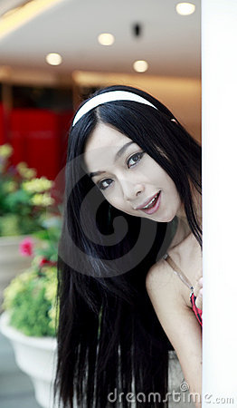 Long-haired girl in hotel