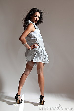 Long legs sexy fashion model poses in short dress
