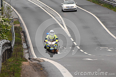 The long road ahead. POLICE motorcycle Editorial Stock Image