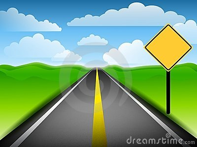 Long Road With Blank Yellow Sign