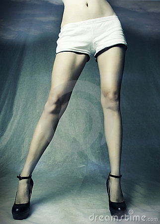 Long sexy slim female legs in black shoes