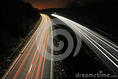 Long shutter speed of cars lights on road