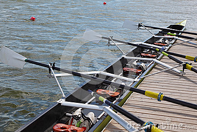 Long sport boat with oars stands