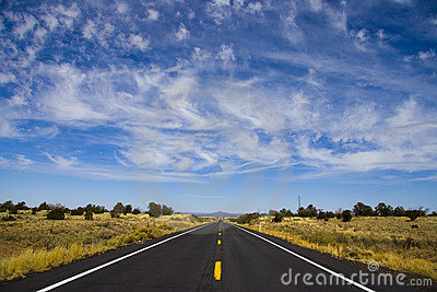Long Straight Road under wispy clouds