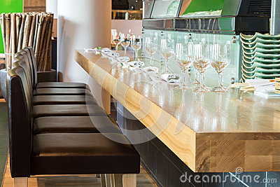 Long table with glasses in the cozy cafe