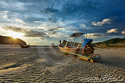 Long tail boat on beach on sunset, Thailand