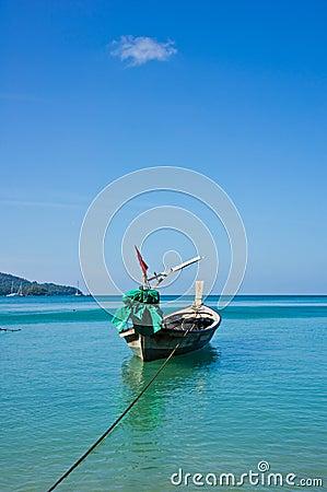 Long tail boat in the ocean.