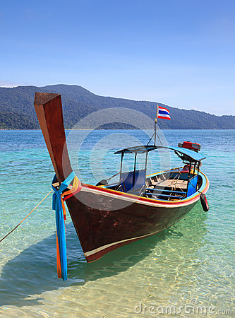 Long tail boat sit on the beach, Thailand