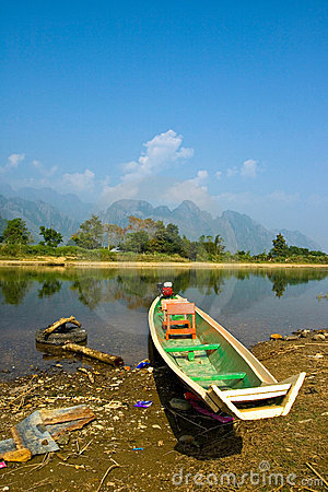 A Long-tailed Boat in Song River