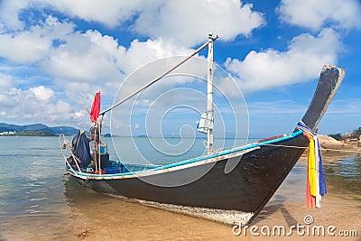 Long thai boat on sand beach