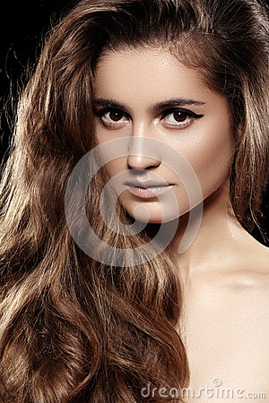 Long volume shiny hair, make-up. Fashion beautiful model face