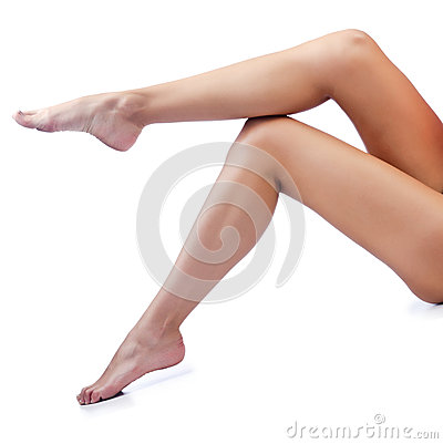 Long woman legs  on white