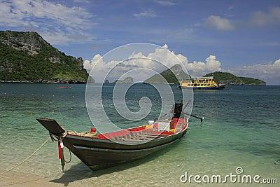 Longtail boat at the beach, Ko Mae Ko island, Ang