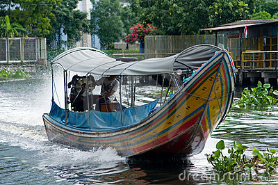 Longtail boat on a canal in Bangkok, Thailand