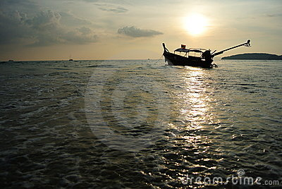 Longtail boat and sunset