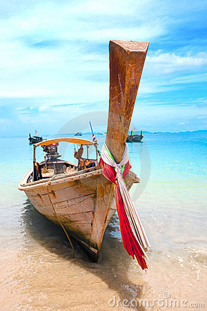Longtail boats moored off the shore in Thailand