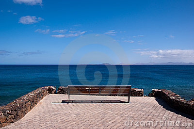 Lonely empty bench in playa blanca