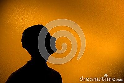 Look ahead - Back lit silhouette of man