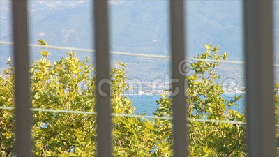 Looking across through the balcony rails stock footage