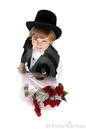 Looking down at a boy in tux holding roses