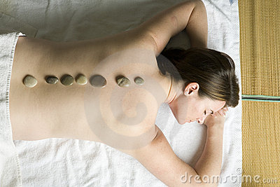 Looking down on a woman having a hot stones treatment