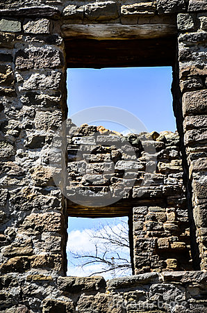 Free Looking Thru Ancient Windows At A Blue Sky With Bare Branches And Clouds Stock Images - 91423734