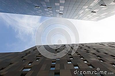 Looking up between two skyscrapers