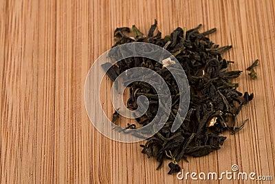 Loose Leaf Green Tea Leaves on Wood