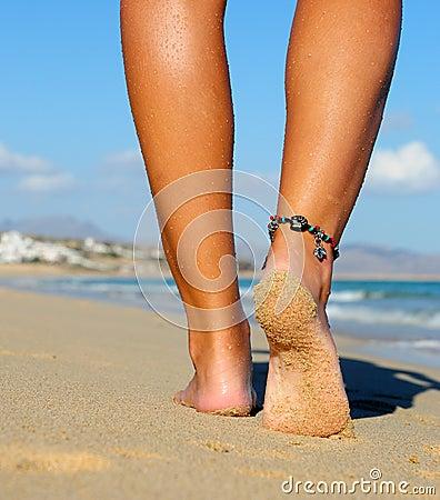 Lopende zandige voet
