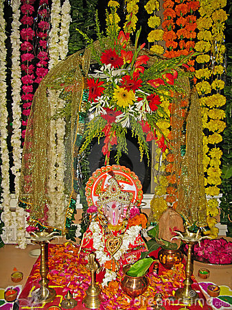 Lord Ganesh with utensils for worship