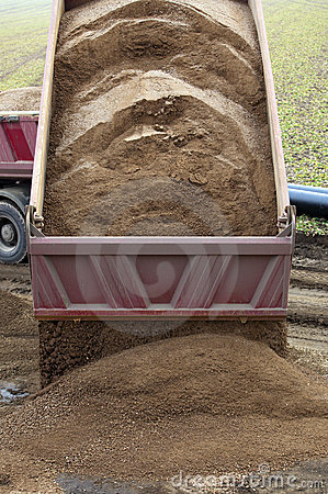 Lorry tipping sand