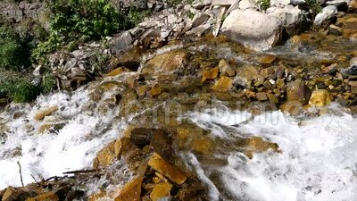 Lost Creek Falls & Lost Creek. Lost Creek Falls spilling between the rocks and down the canyon stock video footage