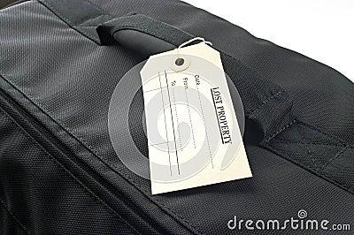 Lost property lable on black bag