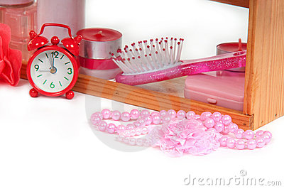 A lot of bath accessories and red alarm clock