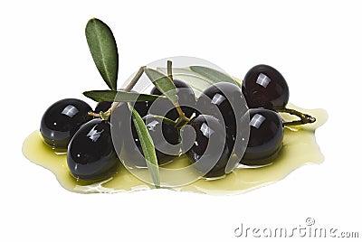 A lot of black olives on olive oil.