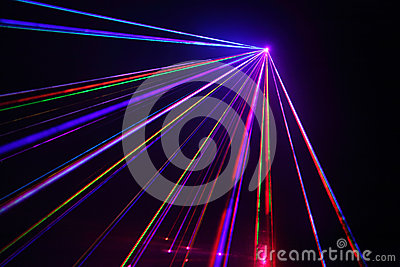 Lot of laser beams in dark at disco.