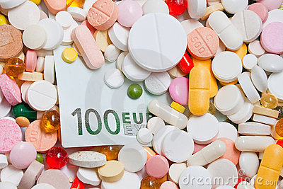 Lot of pills and one hundred euro banknote