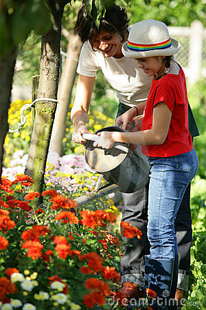 Free Lother And Daughter Watering Plants Royalty Free Stock Photography - 14489447
