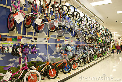 Lots of bikes and helmets for sale in store Editorial Stock Image