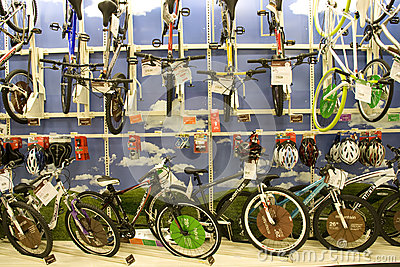 Lots of bikes and helmets for sale in store Editorial Image