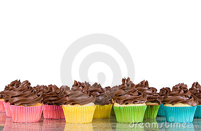 Lots of chocolate frosted cupcakes