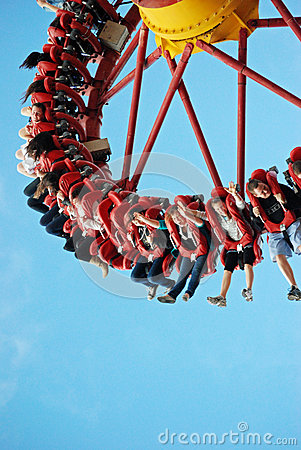 Free Lots Of Teenagers Young People Having Fun On Wild Ride At Theme Park Stock Photography - 86643282