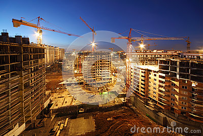 Lots of tower cranes build large residential buildings