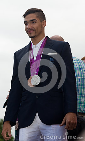 Louis Smith showing off his medals Editorial Stock Image