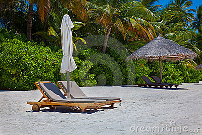 Lounge beach chair on the sand