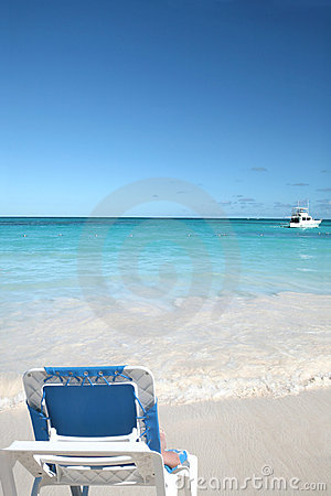 Lounge Chair on White Sand Beach and Ocean