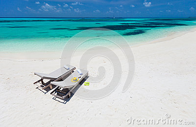 Lounge chairs on a beach