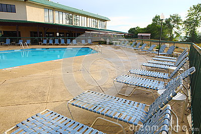 Lounge chairs in the pool edge