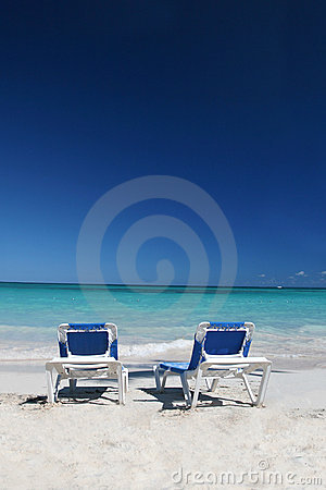 Lounge Chairs on Sand Beach and Ocean