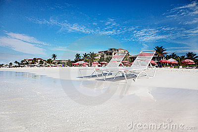 Lounge chairs on tranquil Grace Bay Beach